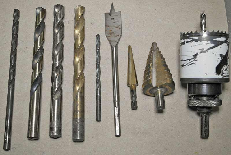 From the left- machinist Cobalt, Standard cobalt, High Speed Steel, Black Oxide, Spade, non-stepped Uni-Bit, stepped Uni-Bit, Bi-Metal Hole Saw.