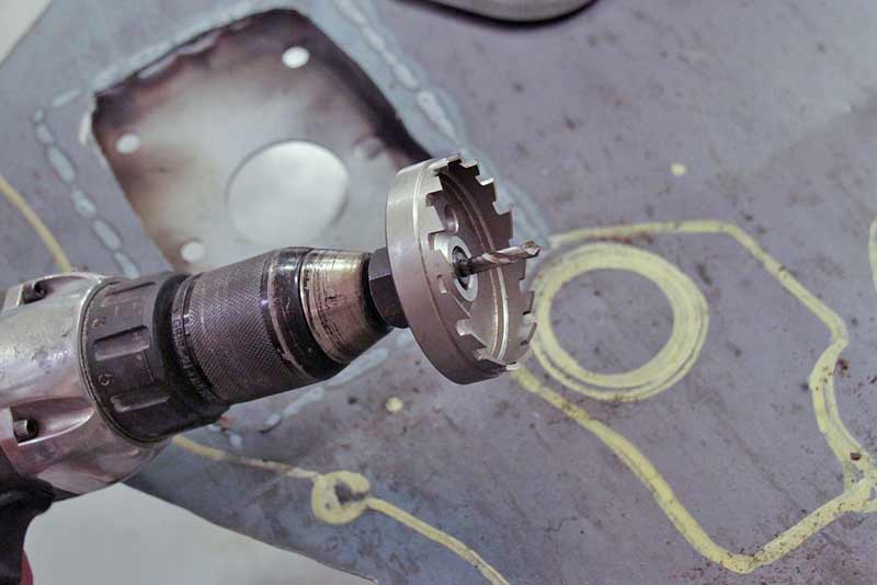 Large holes require a hole saw like this one. This is a broaching saw, which is heavy duty and lasts for a long time. A standard bi-metal hole saw works too.