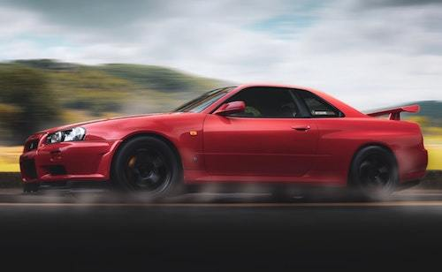 https://www.pexels.com/photo/selective-focus-photography-of-red-nissan-gt-r-r34-skyline-running-on-road-1383834/