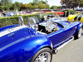 A bright blue classic car parked at a car show
