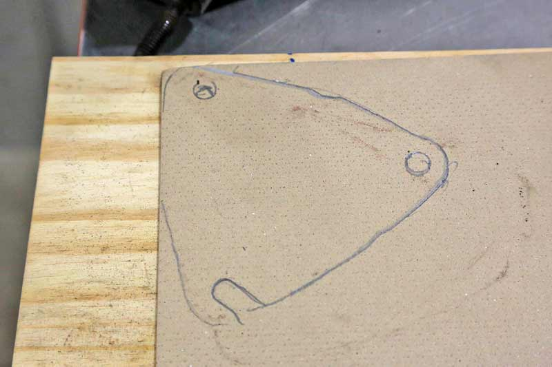 The gaskets have to hold up against the heat and pressure of exhaust, so the Proramic material is perfect. We traced the shape and hole locations onto the material with a pencil.