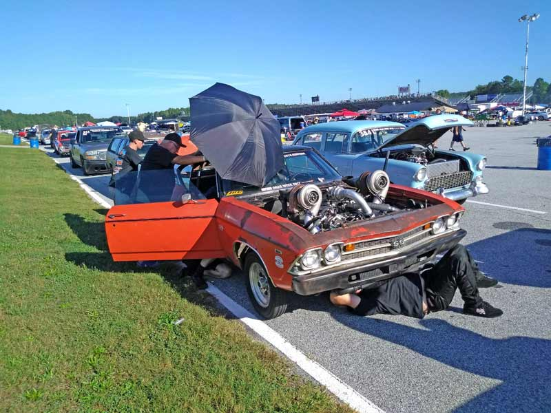 Working on cars in the staging lanes is pretty much normal Drag Week activity.