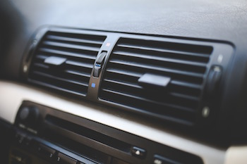 Close-up of an AC vent on a car's dashboard