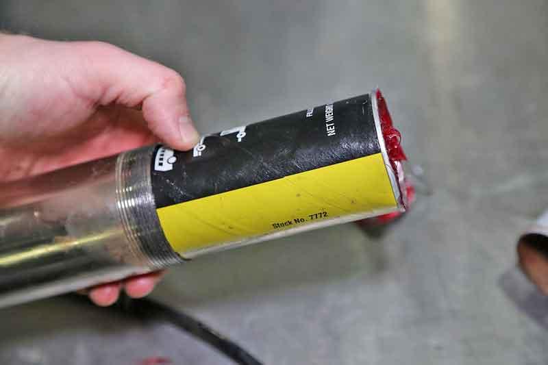 Slip the tube into the barrel like shown.