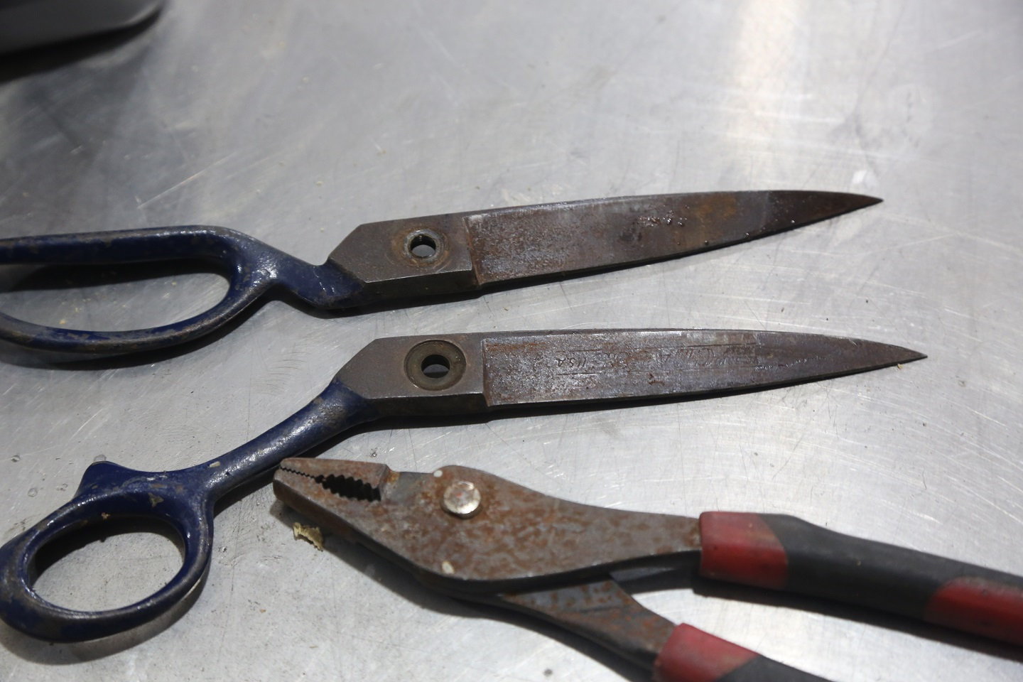 We prepped the tools by taking them apart. The scissors simply unbolted, but the pliers cannot be separated, we just removed the rubber handles.