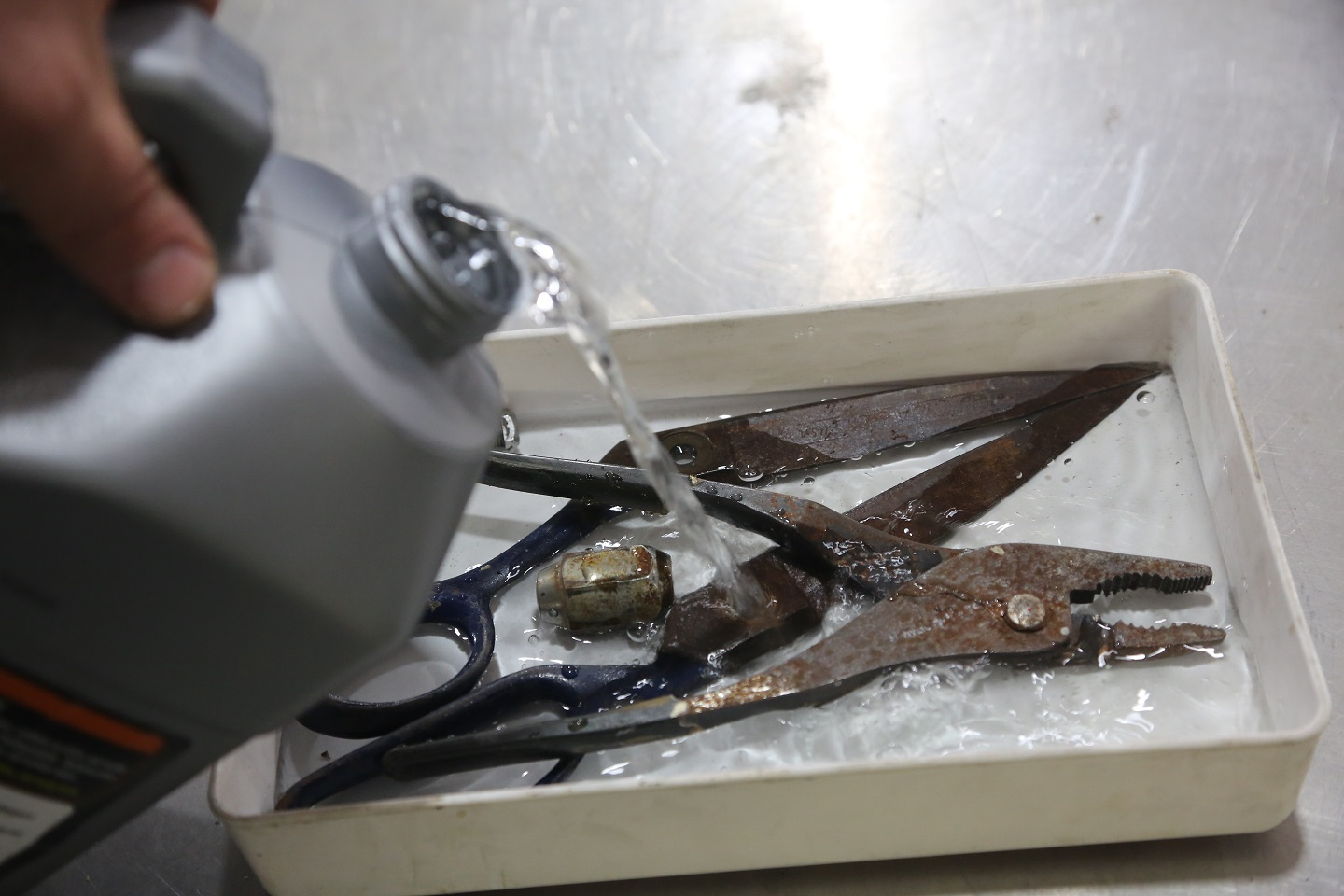 The tools were placed in a plastic tray and covered with just enough WD-40 Rust Remover Soak to cover the rusty bits. Then we left it to soak overnight.