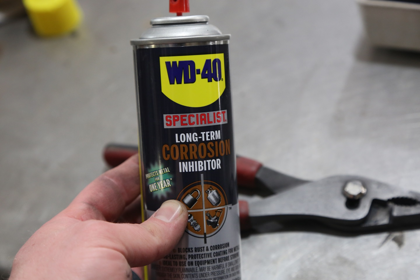 We used WD-40 Long-Term Rust Inhibitor to seal the metal so that it won't rust up.