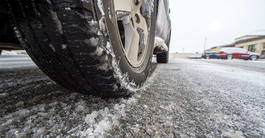 Snow tires on a car. While it makes sense to just put two snow tires on the axle that gets power, here's why that's a bad idea.