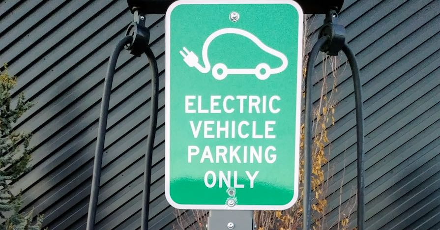 An electric vehicle only parking sign. Look out for these four signs if you think your hybrid car's battery pack is starting to fail.