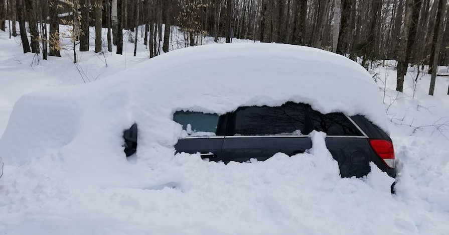 A car buried in snow. Ever wondered how long you should warm your car up? Here are the benefits to warming your car up for a few minutes, and reasons why you shouldn't let it idle for too long.