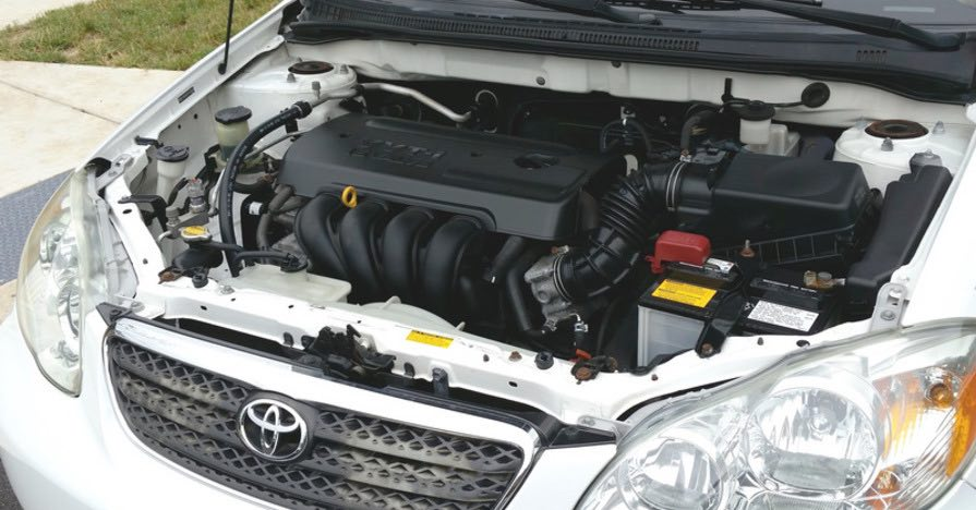 A car battery in an engine bay. What happens once your car's battery runs out of juice? A car battery gets recycled when it reaches the end of its lifespan. Here's how the process works.