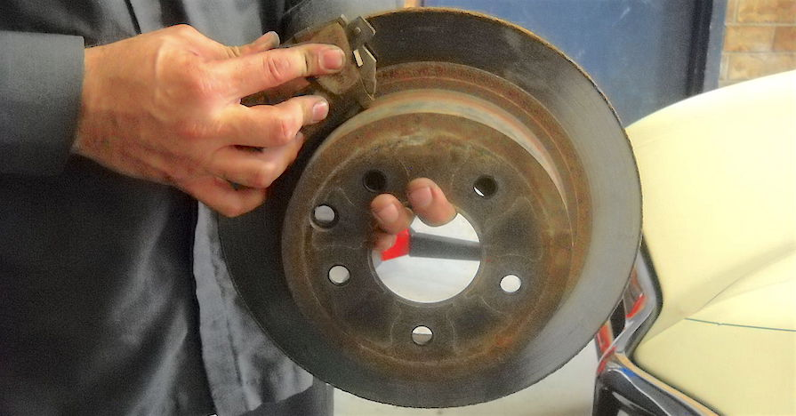 "A brake pad on a rotor. Do you need to change all of your car's brake pads at the same time? While the answer is, ""it depends,"" here's why you should get into a habit of changing your front brake pads at the same time."
