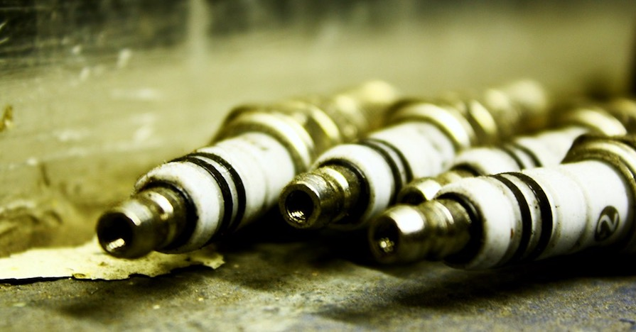 A car's spark plug. There are a lot of different spark plugs to choose from. How do you know which one your car uses? Here's a helpful guide to get the right spark plugs for your car.