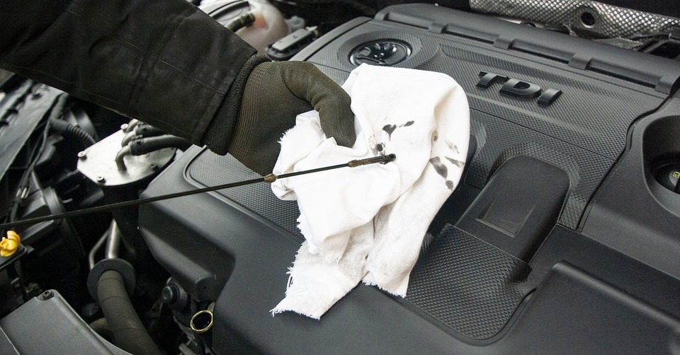 A car's engine oil dipstick. With warm weather upon us, now is the perfect time to go on a road trip. Here are some things you can do before, during and after the trip.