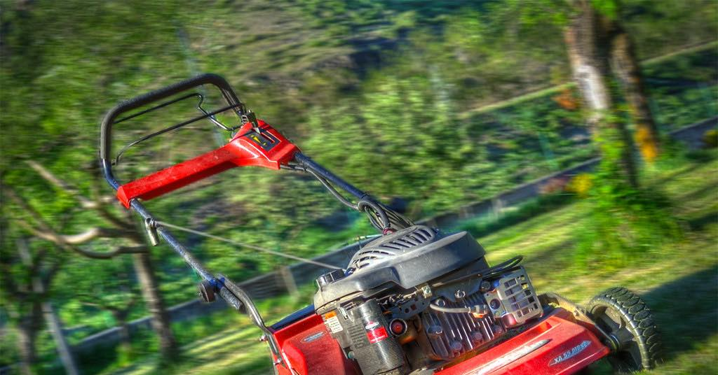 A lawn mower on a green lawn. Going to start your lawn mower and it doesn't start, use these troubleshooting tips to diagnose the problem and get your lawn cut.
