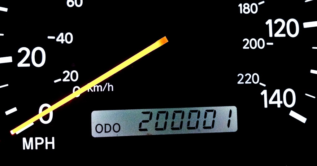 An odometer on a high mileage car. Is high mileage oil a necessity for vehicles with high miles? Is high mileage oil worth the extra cost? Here's why high mileage oil is a good idea for cars with over 75,000 miles.