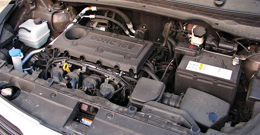 A cramped Kia Sportage engine compartment needs speciality tools