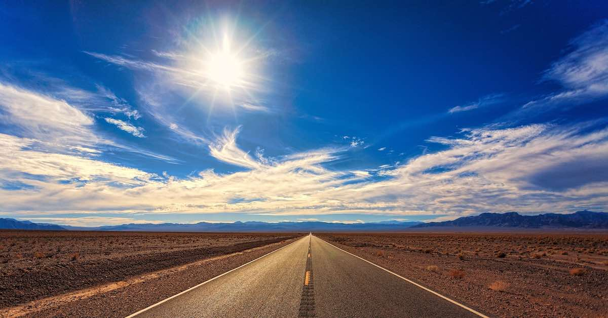 Sun on a road. With summer right around the corner, here are ways heat can affect your car and what to do about it.