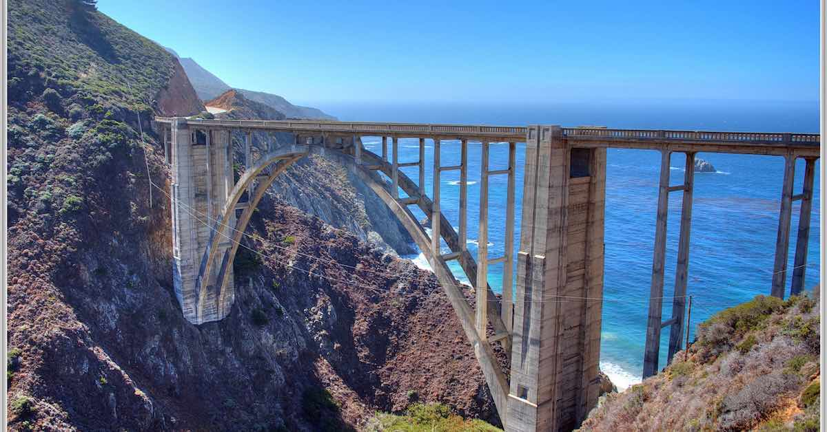 Bixby Bridge in Big Sur, California. Summer is the best time to plan a road trip to California.