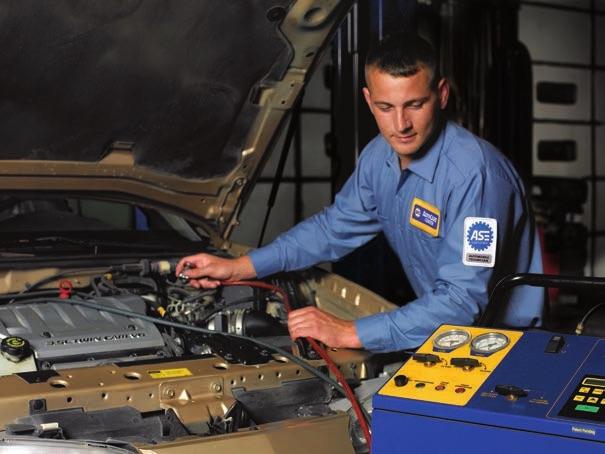 technician using a refrigerant machine