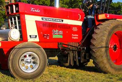 Custom tractor with rims and graphics