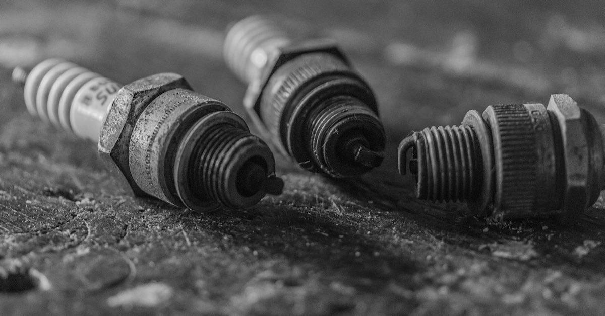 Black-and-white close-up of three spark plugs