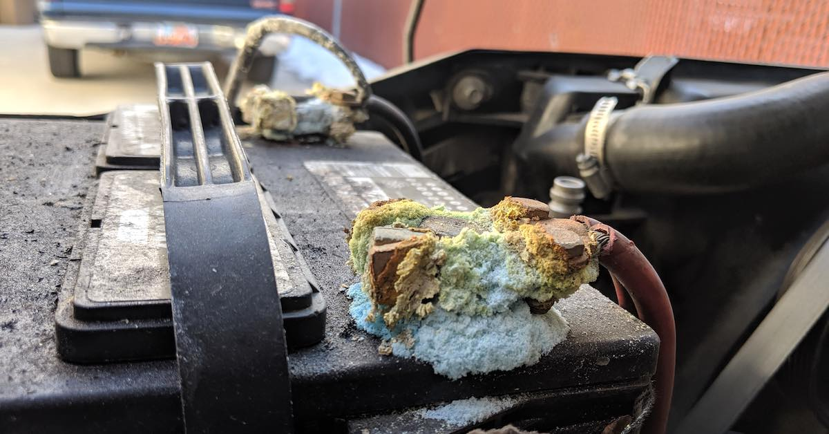 Close-up of a car battery with residue buildup at the terminals