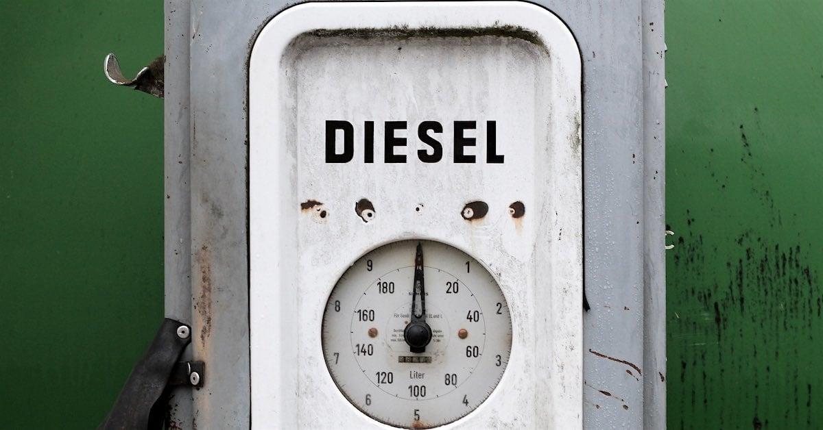 Rusty diesel fuel gauge against a green background