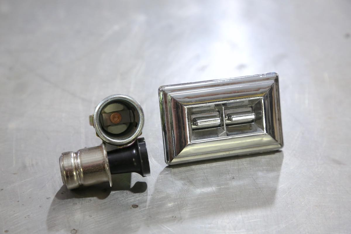 Automotive electronic components like lighters and window switches.
