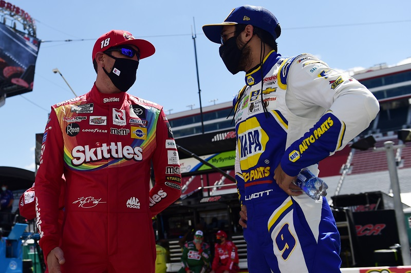 BRISTOL, TENNESSEE - MAY 31: Kyle Busch, driver of the #18 Skittles Toyota, talks with Chase Elliott, driver of the #9 NAPA Auto Parts Chevrolet, during the NASCAR Cup Series Food City presents the Supermarket Heroes 500 at Bristol Motor Speedway on May 31, 2020 in Bristol, Tennessee. (Photo by Jared C. Tilton/Getty Images)