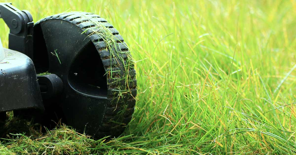 Lawn mower wheel in tall grass