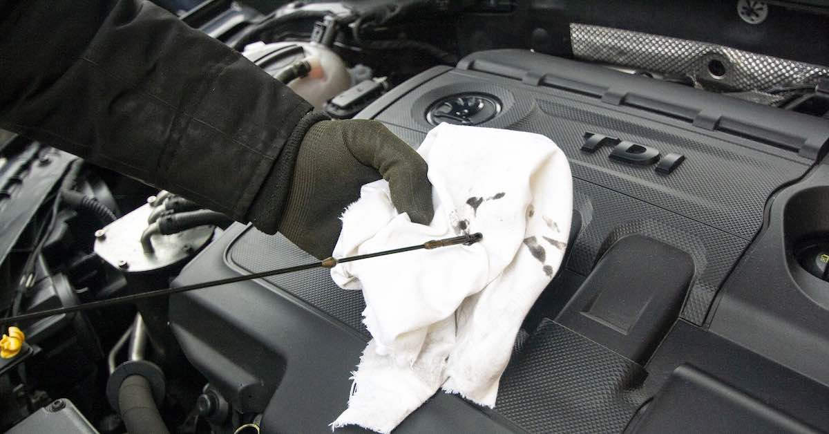 Wiping off an oil dipstick on a cloth