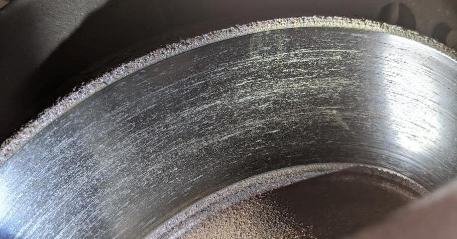 Close-up of a dirty brake rotor
