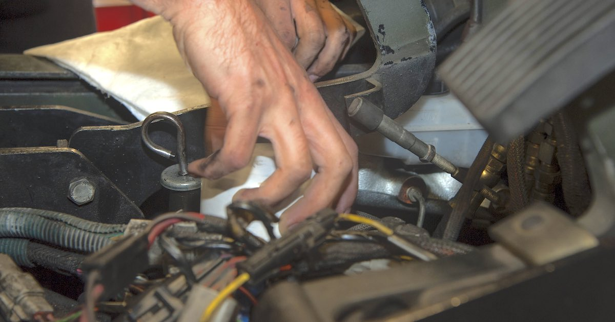 Technician installing new engine oil filter