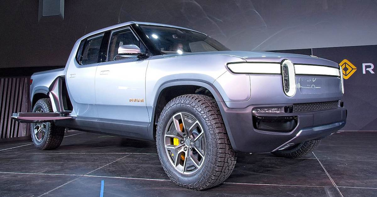 Rivan electric pickup truck prototype on display at an auto show.