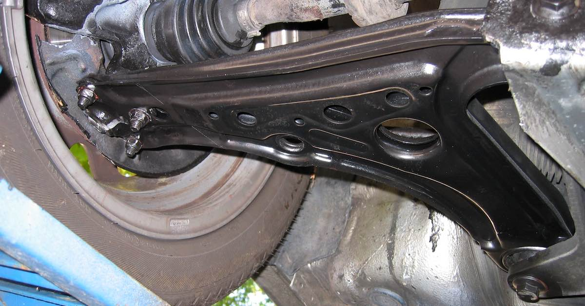 Control arm with bushings
