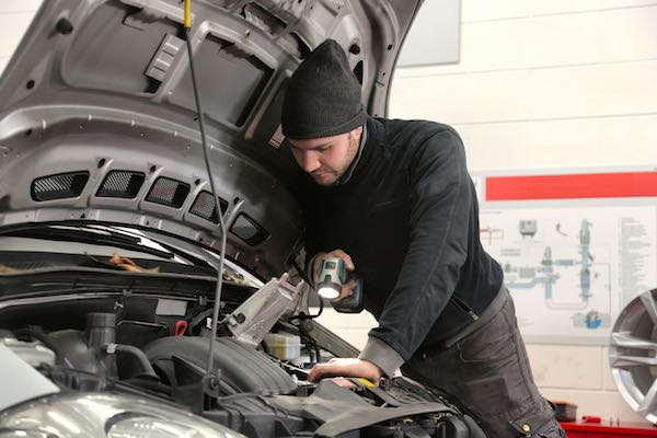 Mechanic checking transmission fluid