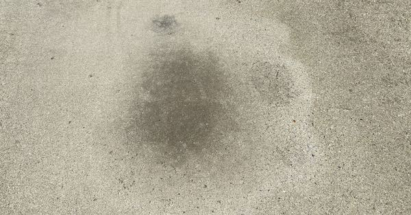 Removing oil stains from concrete