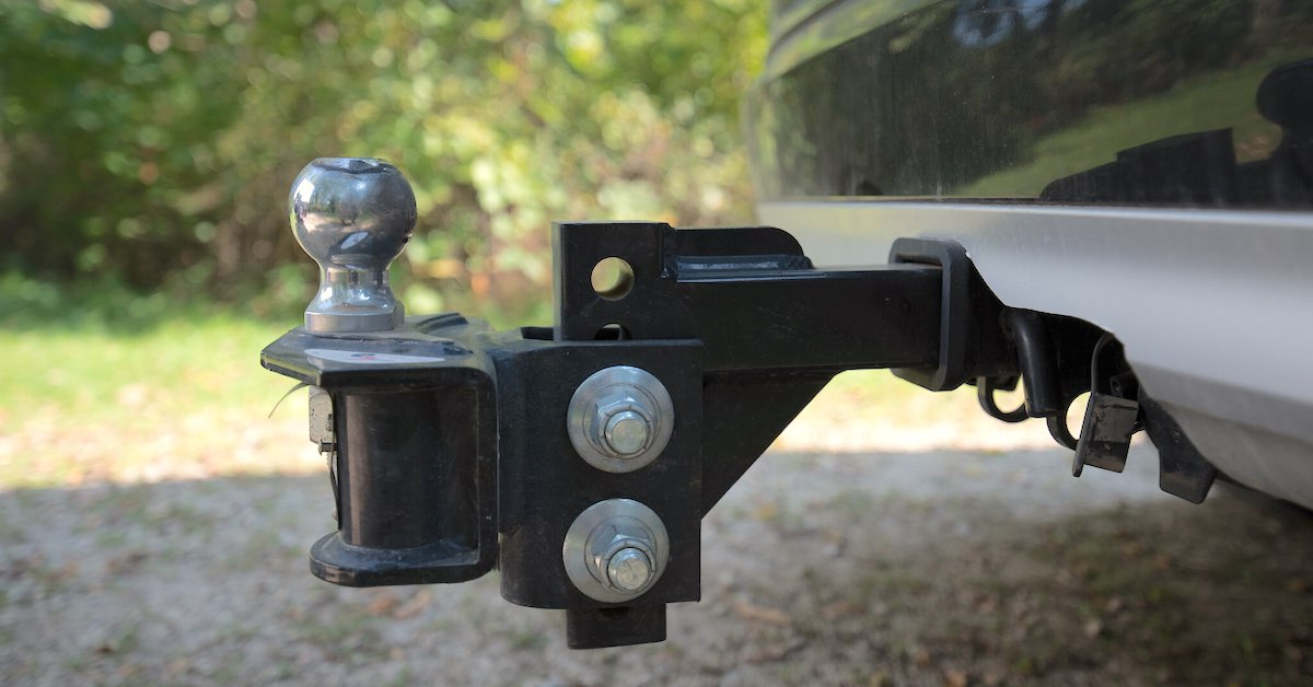 A weight distribution and sway control trailer hitch and ball for RVs and trailer towing