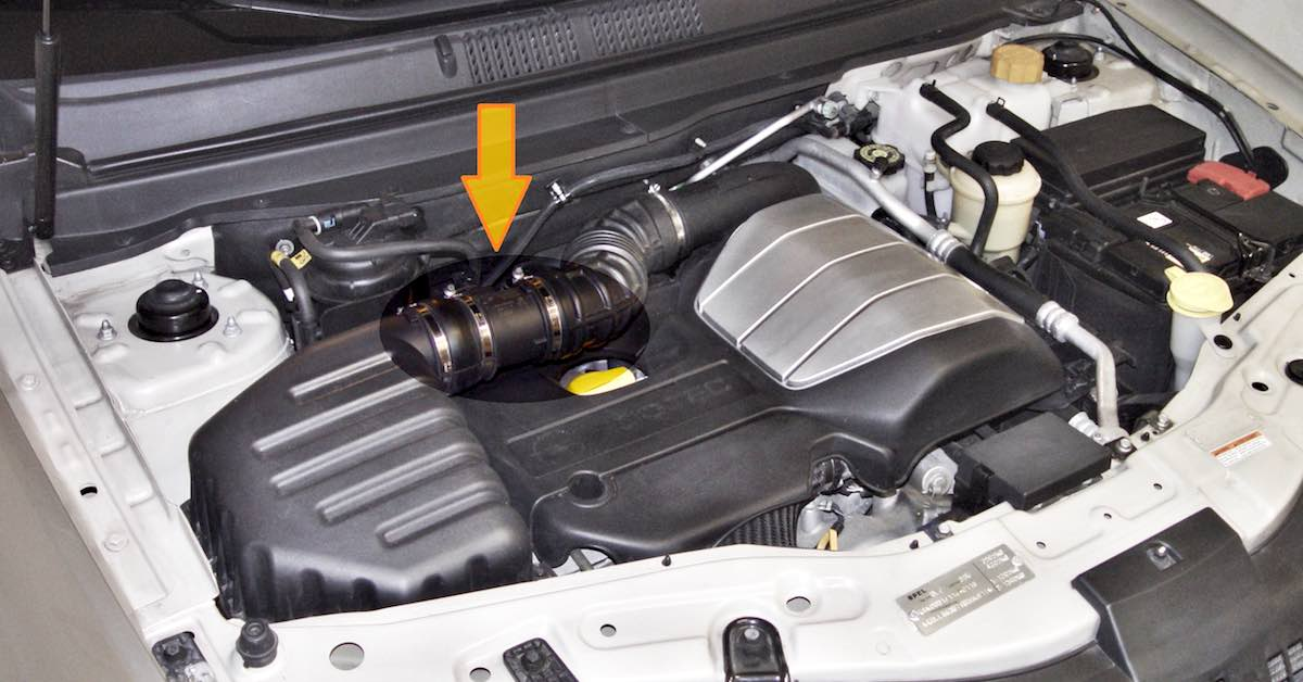 An arrow points to the mass air flow sensor in the engine bay
