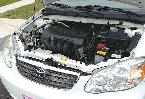 car with raised hood