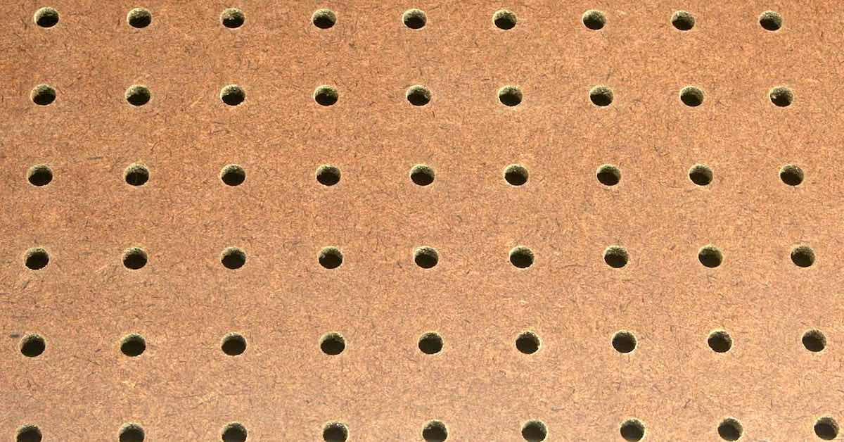 Brown hardboard pegboard.