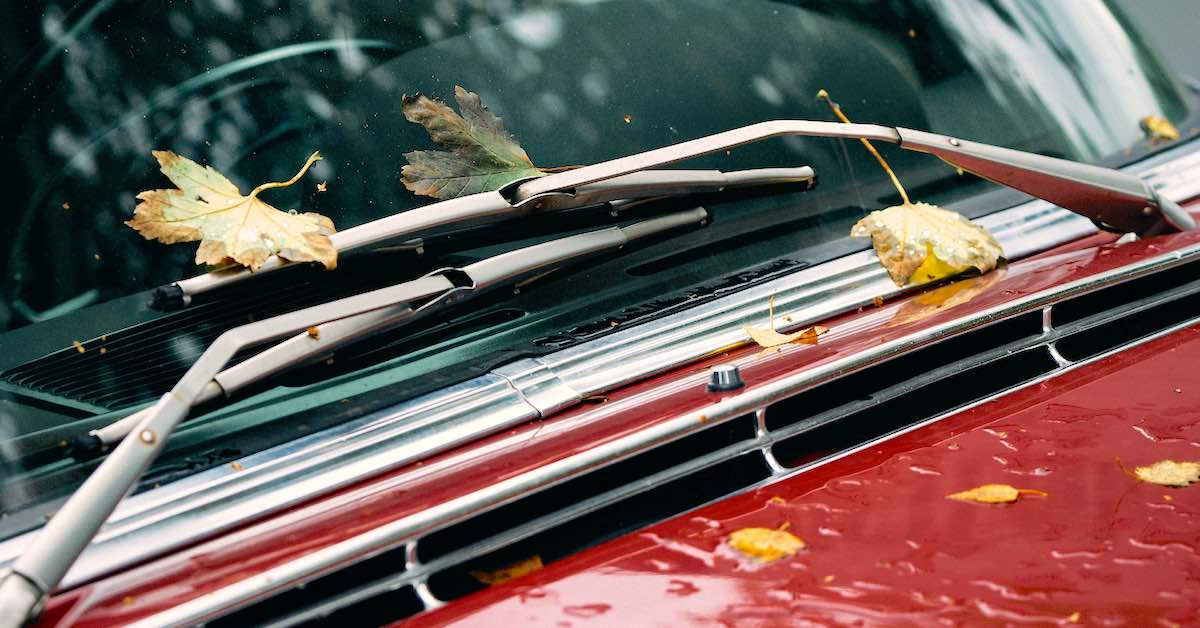 Windshield wipers on a red vintage car.