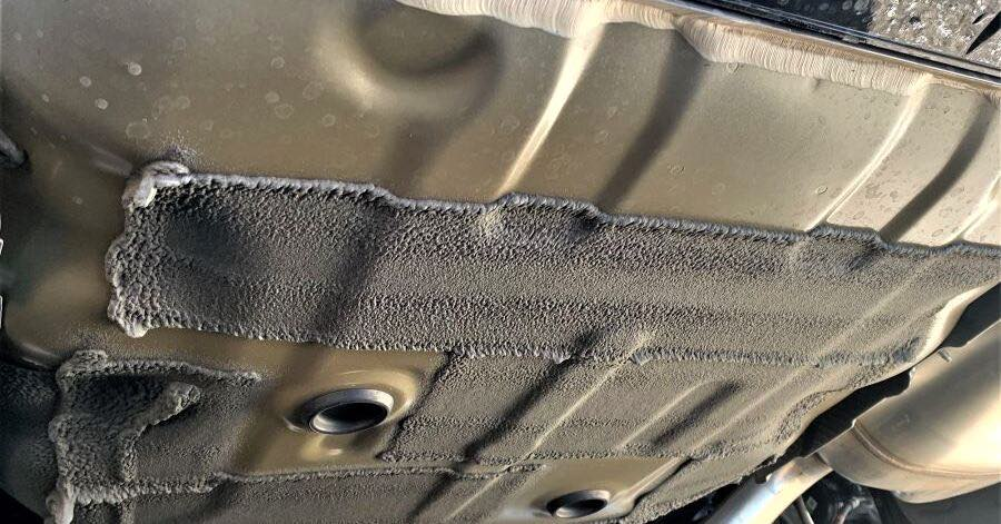 The gas tank of a car as seen from underneath