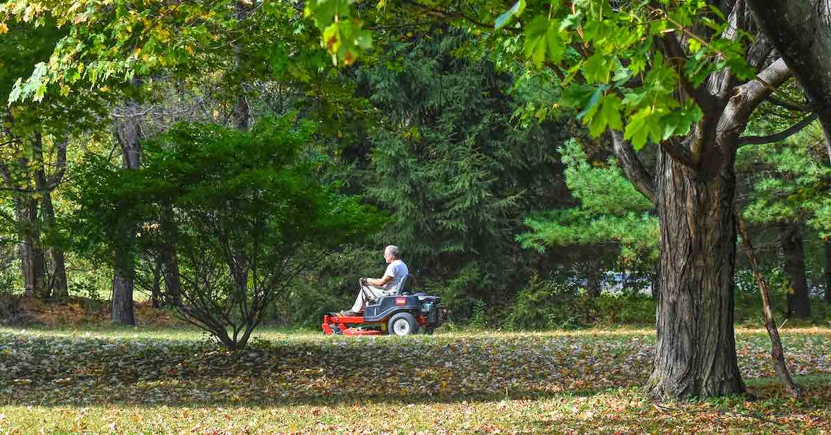 A lawn tractor parked in a yard.
