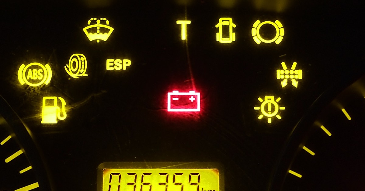 A low battery warning light in a car's instrument cluster.