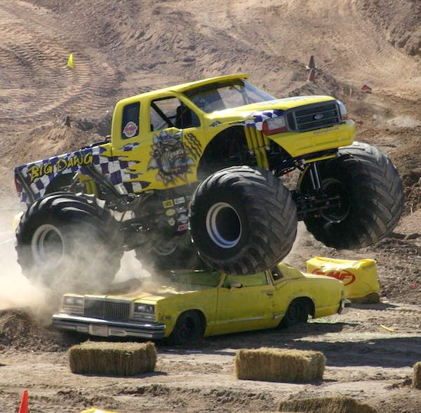 Monster truck crushes a car.