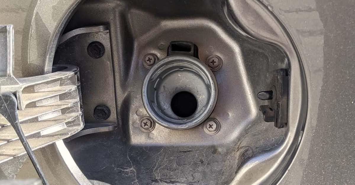 A fuel tank filler neck.