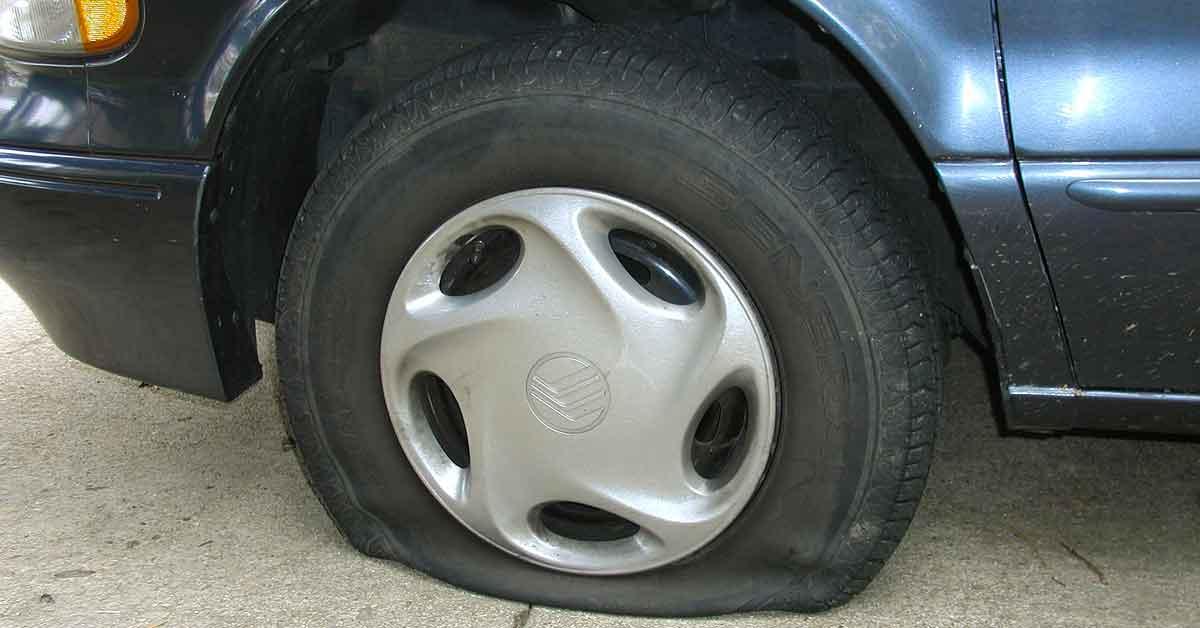 A flat tire on a vehicle.