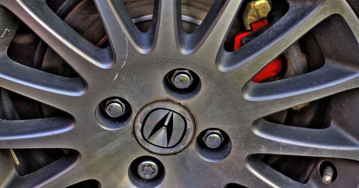 Acura car wheel with lug nuts